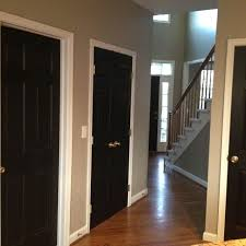 i see a white builder grade door and i want to paint it black