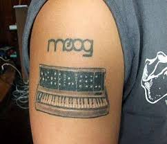 nice piano keyboard tattoo on right shoulder