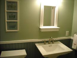 green wall paint mirror with white wooden frame wall lamps