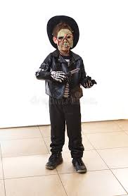 8 year old boy dressed as a zombie for halloween purim stock
