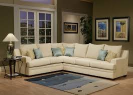 Light Colored Leather Sofa Sectional Sofa With Light Teal Satin Cushions In Natural Color
