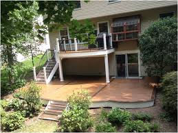 creating an outdoor deck design above a walkout patio amazing decks
