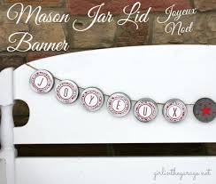 mason jar lid christmas banner in the garage