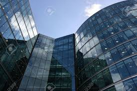 london glass building skyscraper in london ultramodern steel and glass building stock