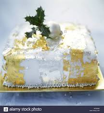 Christmas Cake Decorations Edible by Christmas Cake With Edible Gold And Silver Leaf Decorations Stock