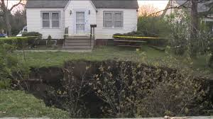 Sinkhole In Backyard Giant Sinkhole Swallows Des Moines Front Yard Whotv Com