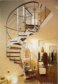 interior wooden staircare railing with iron with bricks flooring