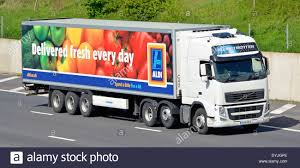 volvo lorry aldi supermarket delivery trailer and volvo truck on m25 motorway
