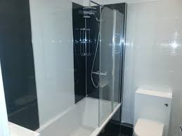 bathroom s paladin kitchens close couple toilet boxed in bath bar style with sliding rail and fixed head shower two part folding shower door square vanity sink unit with sink and