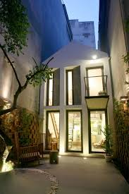 Home Courtyard by Maison T In Vietnam Features A Beautiful And Unique Courtyard