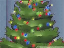 how to hang lights on a christmas tree 3 ways to hang lights on a christmas tree wikihow