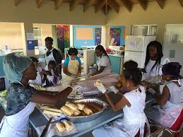 students help to rebuild their hurricane hit island ib community