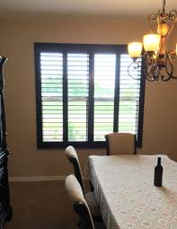 stained north american hardwood shutters installation by budget
