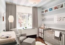nursery room with stripes walls and grey crib cleaning ways for