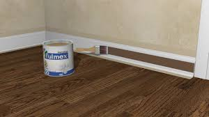 How To Lay Laminate Flooring Around Doors How To Install Baseboards With Pictures Wikihow