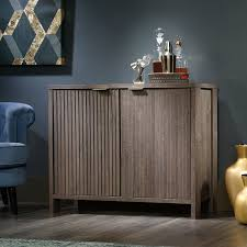 amazon com sauder international lux sideboard in fossil oak