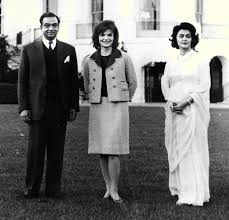 first lady jaqueline kennedy center poses for a photograph with
