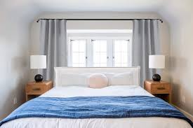 how do you make an upholstered headboard ask the audience master bed in front of window emily henderson