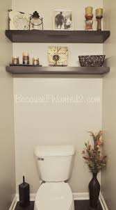 small restroom decoration ideas chic small restroom decoration ideas with dark wall mounted shelf