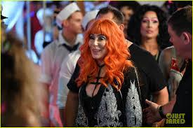 orange mardi gras cher wears a bright orange wig for mardi gras in sydney photo