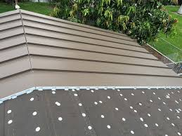 putting on a metal roof over shingles