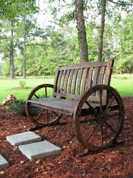 Wagon Wheel Rocking Chair I Love Things With Character And This Wagon Wheel Bench Has