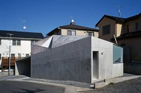 modern concrete house built on a budget and featuring an irregular