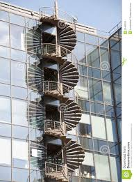 spiral fire escape staircase on external wall of office block