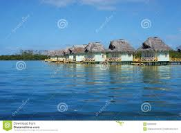 caribbean overwater bungalows with thatched roof stock photo