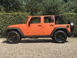 orange jeep used 2009 jeep wrangler unlimited sport for sale in