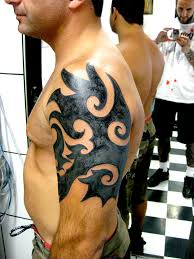 cool tribal tattoos on arm and chest real photo pictures images