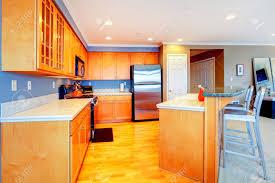 Kitchen With Bar Design City Apartment Orange Wood Kitchen With Bar Stools Stock Photo