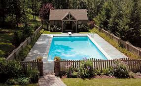 Backyard Pool Houses like this pool and little pool house the fence is also very cute