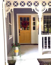 farmhouse porch dovetail gray exterior and mustard door at home
