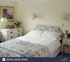 blue white toile de jouy quilt and matching upholstered headboard