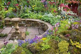 Raised Rock Garden Beds Mixed Garden Bed And Patio Plant Flower Stock Photography