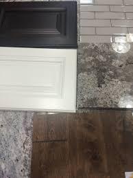 bianco antico granite with white cabinets bright white wall cabinets espresso island birch suede flooring
