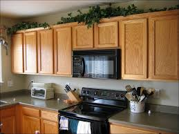 decorating above kitchen cabinets with high ceilings kitchen