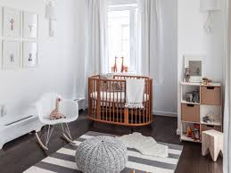 baby nursery oval brown varnished wood crib with round gray