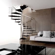 square spiral staircase with sofa and cushion also black table