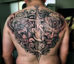 collection of 25 scroll sword tattoos on back