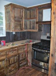 we built these barn wood cabinets and used old tin for a back