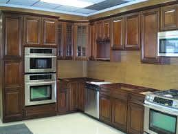 Brown Tile Backsplash by Brown Wooden Kitchen Cabinet And Cream Backsplash Also Cream