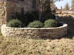 stacked stone flower bed edging by c3 backyard oasis llc in trophy