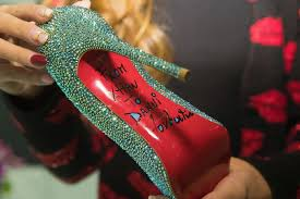 why do louboutins have those red soles