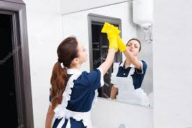how to clean mirrors in bathroom maid cleaning bathroom mirror with sponge stock photo vaicheslav