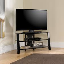 black brushed metal tv stand having three tier shelves placed on