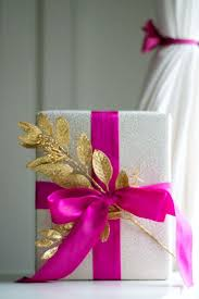 silver glitter wrapping paper silver glitter wrapping paper and a bright fuchsia bow this