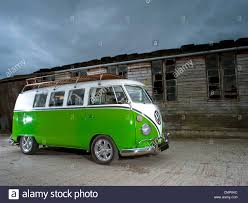 dark green volkswagen green vw volkswagen split screen camper van bus lowered modified