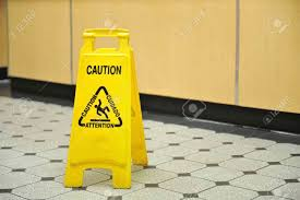 Wet Floor Images by A Yellow Caution Sign Warning Of Slippery Wet Floors Sits On